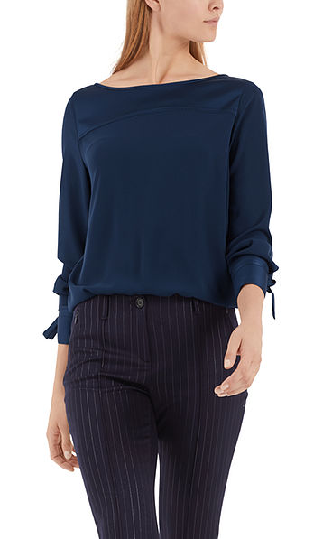 Elegant blouse-style top with ribbons